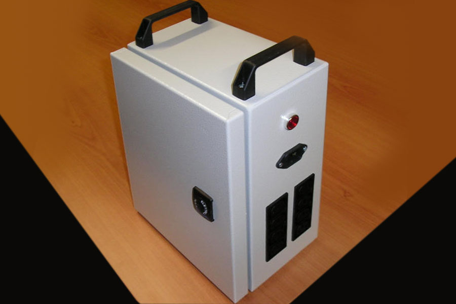 Boxed transformer with IEC electric sockets